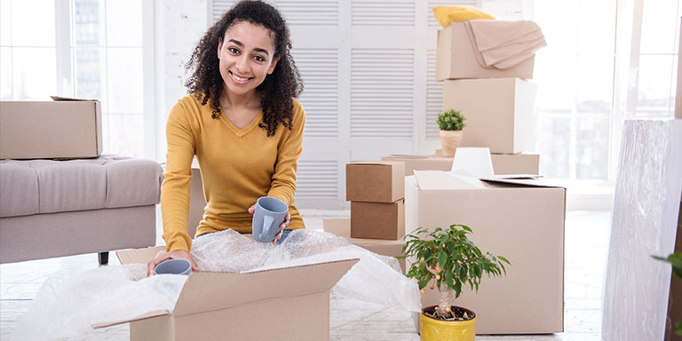 Woman Packing Delicate Fragile Items