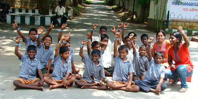 Peace child India students sitting on entrance